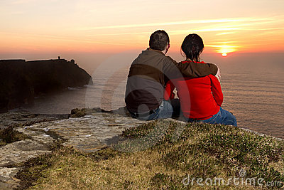 Couple watching lovely sunset