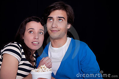 Couple watching tv/cinema,  with popcorn