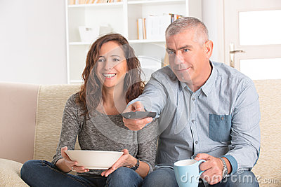 Couple watching tv in their living room