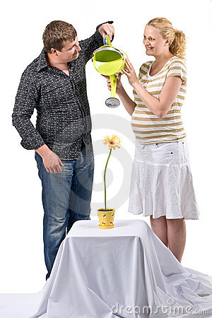 Couple watering flower