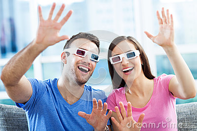 Couple wearing 3d glasses