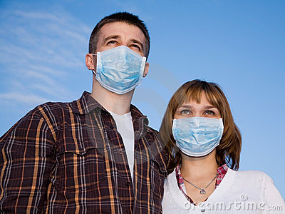 Couple wearing flu masks