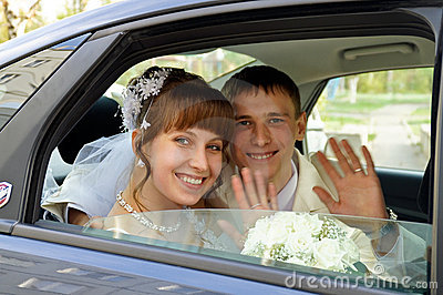 The couple in a wedding car
