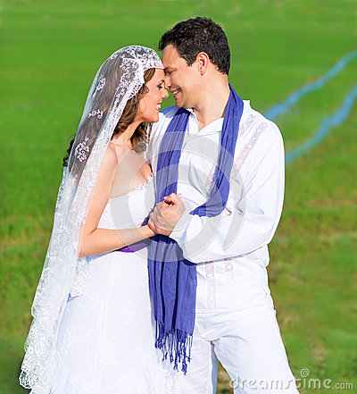 Couple In Wedding Day Hug In Green Meadow Stock Photos - Image: 25896663