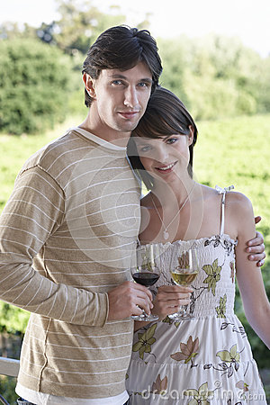 Couple With Wineglasses At Field