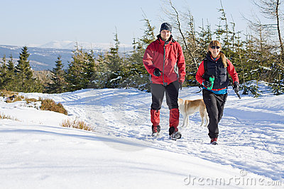 Couple on winter hiking in mountains