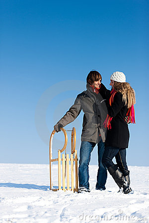 Couple in winter with sled