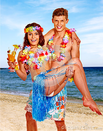Free Couple With Cocktail At Hawaii Wreath Beach Royalty Free Stock Photography - 54817497