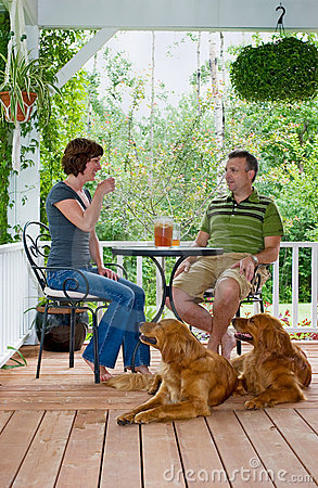 Free Couple With Dogs On Porch Royalty Free Stock Photography - 8831507