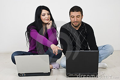 Couple working on laptop home