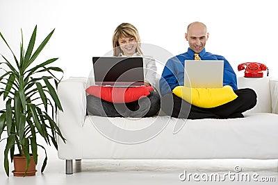 Couple Working on Laptops