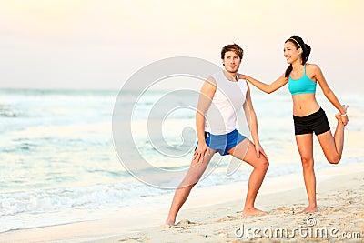 Couple workout training on beach