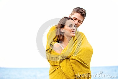 Couple Wrapped with Blanket Embracing