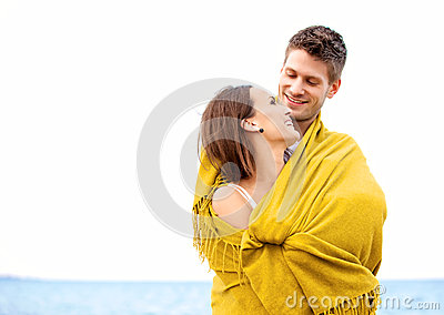 Couple Wrapped with Blanket Looking at Each Other