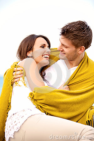 Couple Wrapped in Blanket Looking at Each Other