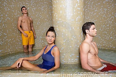 Couple young in cool spa water pool after sauna