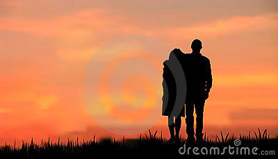 Couples as a silhouette against sunset/sunrise