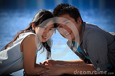 Couples of asian man and woman at water pool