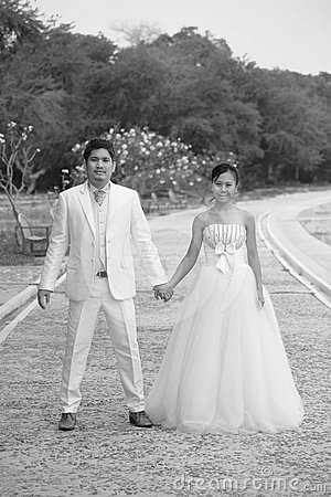 Couples of asian people in wedding suit standing