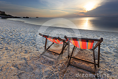 Couples chairs beach and sunset