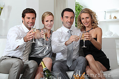 Couples drinking champagne