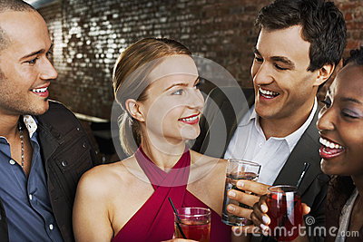 Couples With Drinks At Bar