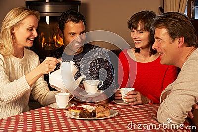 Couples Enjoying Tea And Cake Together
