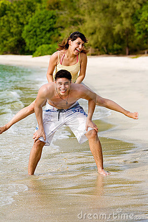 Couples having fun by the beach
