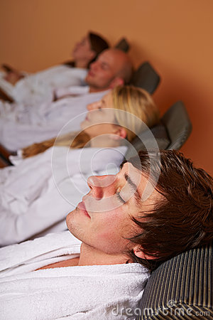 Couples resting in relaxation room