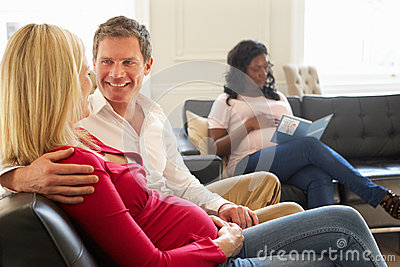 Couples In Waiting Room Of Ante Natal Clinic