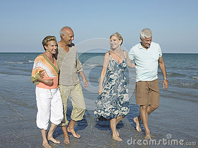 Couples Walking Together On Tropical Beach