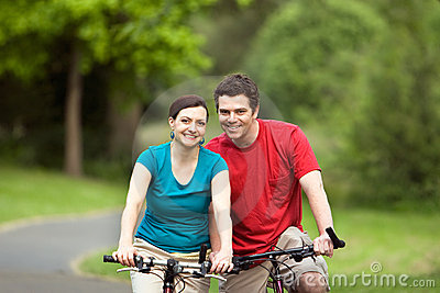 Couply Smiling on Bicycyles - horizontal