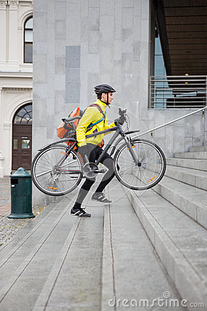 Courier Delivery Man With Bicycle And Backpack