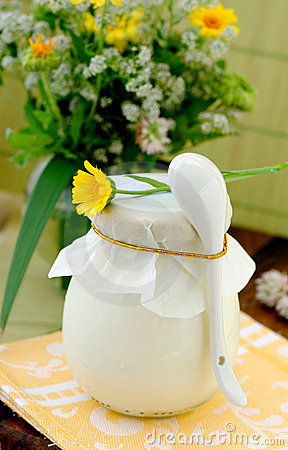 Covered jar with some dairy product