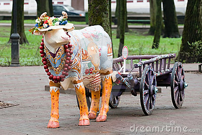 A cow with a cart