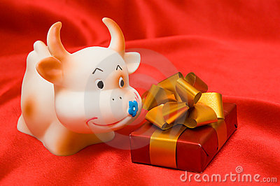 Cow and a gift on a red