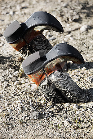 Free Cowboy Boots Buried In Dirt Stock Image - 5252081