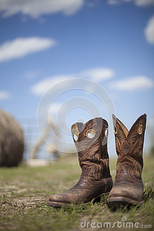 Cowboy boots in pasture
