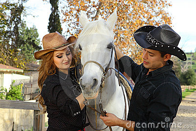 Cowboy and Cowgirl with horse