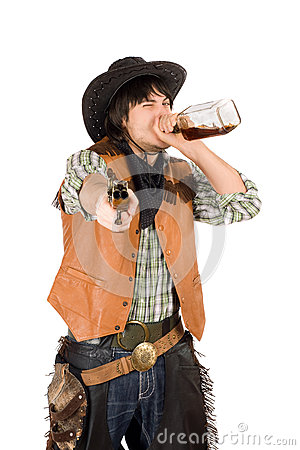 Cowboy drinking whiskey from the bottle. Isolated on white.