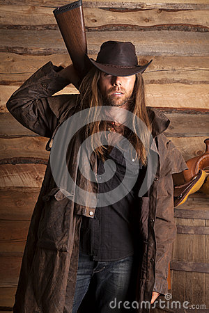 Free Cowboy Duster Long Hair Rifle Behind Back Royalty Free Stock Photography - 36116997