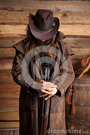 Free Cowboy Duster Long Hair Rifle Look Down Wall Royalty Free Stock Images - 36117039
