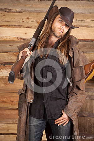Free Cowboy Duster Long Hair Rifle On Shoulder Look Stock Images - 36117034
