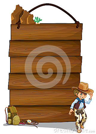 A cowboy and the empty wooden signboards