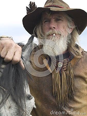 Cowboy en zijn paard