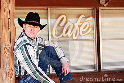 Cowboy in Front of Cafe