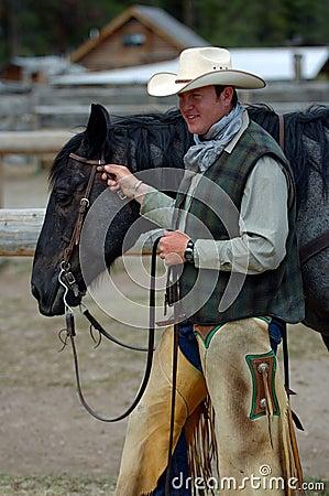Cowboy Holding Blue Roan Horse