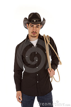 Cowboy holding rope over shoulder