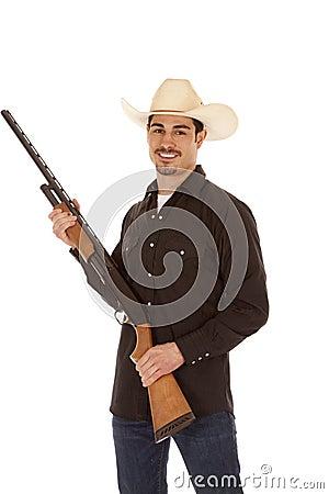Cowboy holding shotgun smile