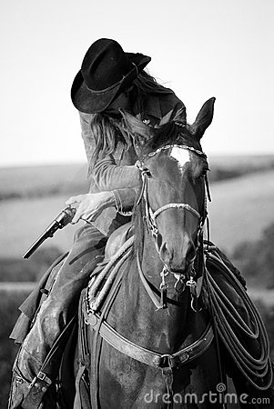 Cowboy on a horse with a gun